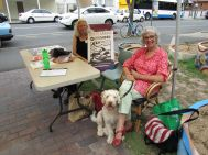 Patrice Draper welcomed community members while Penny Bristol-Jones helped out on the dog minding front.